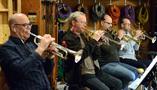 Dan Fornero, Jon Lewis, Dan Rosenboom and Dustin McKinney on trumpets