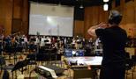 Jasper Randall conducts the choir