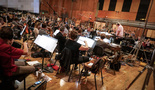 Conductor Tim Simonec conducts the Hollywood Studio Symphony