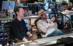 Director Matt Reeves and composer Michael Giacchino watch the choir record