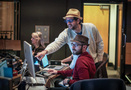 Composer Michael Giacchino goes over a cue with music editor Paul Apelgren