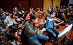 The violins warm up