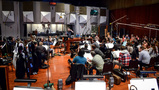 Composer/conductor Christopher Lennertz records with the orchestra