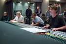 Orchestrator Jonathan Sacks, composer Randy Newman, director Brian Fee, and scoring mixer Dave Boucher (front row) listen to a cue playback on <em>Cars 3</em>