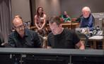 Composer Randy Kerber and scoring mixer Adam Michalak go over a cue