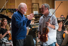 Visiting guest John Williams talks with concertmaster Roger Wilkie