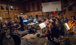 Orchestrator Ed Trybeck conducts the strings