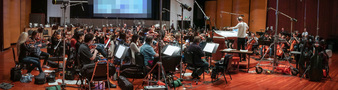 Conductor Nick Glennie-Smith and the orchestra perform a cue from <i>Despicable Me 3</i>