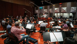 The Hollywood Studio Symphony strings and woodwinds record with conductor Nick Glennie-Smith