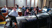 Orchestrator Jonathan Beard and composer Heitor Pereira go over a cue as director Pierre Coffin watches the session and scoring mixer Greg Hayes (turned) talks with the rest of the music team