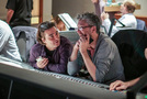 Composer Heitor Pereira discusses a scene with director Pierre Coffin