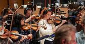 The violin section performs on <em>Despicable Me 3</em>