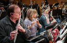 The woodwind section performs