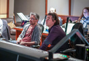 Director Pierre Coffin and composer Heitor Pereira watch the session