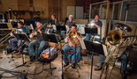 The brass section: Barry Perkins, Jon Lewis, and Rob Schaer on trumpet; Steve Holtman, Alex Iles, and Craig Gosnell on trombone, and Doug Tornquist on tuba