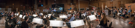Composer Rolfe Kent conducts the orchestra as they record his score for <i>Downsizing</i>