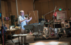 Composer/conductor Rolfe Kent performs with the orchestra