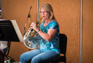 Stephanie Stetson performs French horn on <i>Downsizing</i>