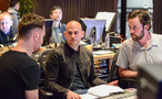 Composer Brian Tyler (left) talks about a cue with supervising music editor Joe Lisanti and scoring mixer Greg Hayes