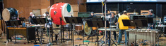 The percussion section prepares to record
