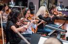 The violins record a cue