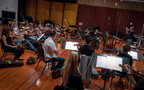 Composer/conductor Blake Neely and the orchestra perform