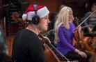 A festive cellist performs