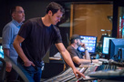 Scoring mixer Chris Fogel (rear) and composer Ramin Djawadi listen to a cue