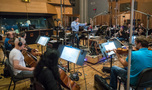 Ramin Djawadi conducts the strings on <em>The Mountain Between Us</em>