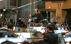 Composer/conductor Bruce Broughton and the orchestra