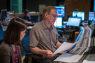Orchestrator Dave Slonaker looks over a cue
