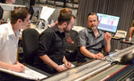 Additional music composers Zak McNeil and Phill Boucher go over a cue with composer Geoff Zanelli