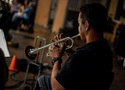 Barry Perkins performs on trumpet