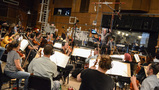 Nick Glennie-Smith conducts the strings and woodwinds