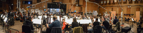The orchestra and conductor Nick Glennie-Smith record a cue from <i>Pirates of the Caribbean: Dead Men Tell No Tales</i>