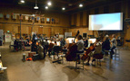 Conductor/orchestrator Tim Davies and the Hollywood Studio Symphony prepare to record with the playback