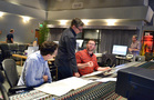 Composer Matthew Margeson discusses a cue with orchestrator Jeremy Levy (left) and conductor/orchestrator Tim Davies (center)