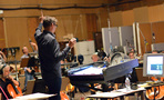 Conductor/orchestrator Tim Davies readies the orchestra