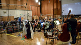 Conductor Pete Anthony and the orchestra prepare to record with the playback