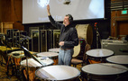 Timpanist Gregory Goodall asks a question about his part