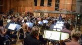 Conductor Pete Anthony goes over a cue with the orchestra