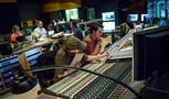 Orchestrator Robert Litton and co-composer Chris Bacon go over a cue