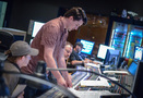 Composer Chris Bacon reviews a cue with orchestrator Robert Litton and scoring mixer Casey Stone