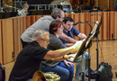 Music librarian Josef Zimmerman and the French horn section make a change in their parts