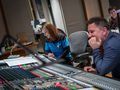 Orchestrator Amie Doherty and scoring mixer Michael Perfitt share a laugh during the session