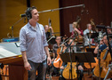 Composer/conductor Jeff Russo talks to the booth