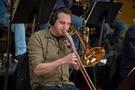 Noah Gladstone performs on trombone