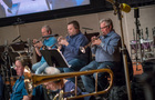 Jon Lewis, Rob Schaer, and David Washburn perform on trumpet