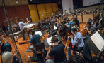 Composer/conductor Jeff Russo performs a cue with the orchestra