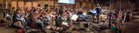 Composer/conductor Pinar Toprak records a cue with the Hollywood Studio Symphony